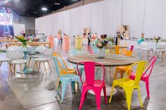Seating options at the closing party were a mix of colorful chairs, funky ottomans, swing chairs, and branded throw...