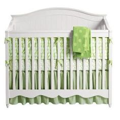 White crib with green bedding