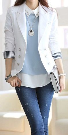 Soft blue mixed with crisp white and black; nice menswear-inspired outfit.  Replace the nasty frayed jeans with pants and we're good to go.