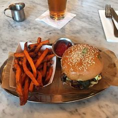 Mouthwatering burger paired with sweet potato fries at Alpharetta's Bocado Burger located inside Avalon.