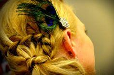 waterfall braid with peacock hair pin
