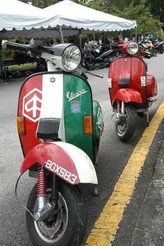 Riding a Vespa through the towns of Italy.