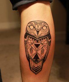 black aztec tribal owl forearm tattoo