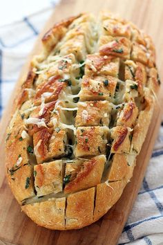 Cheesy Garlic Herb Crack Bread is outrageously buttery and cheesy with each pull-apart piece and bursting with fresh herb and garlic flavors. Easy because you buy the bread. The BEST! Crack Bread, Herb Bread, Cheesy Garlic Bread, Garlic Cheese, Good Food, Yummy Food, Healthy Food, Cheese Bread, Daiya Cheese