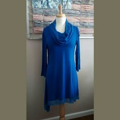 Royal Blue Cable and Gauge Dress/Tunic Versatile Piece to add to your wardrobe.  Pair with a pair of black tights/leggings and black boots.  It is cut on a bias for a slimming look. Cable & Gauge Dresses Midi