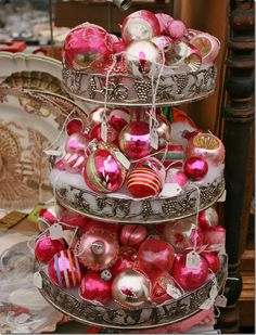 great idea to put Christmas Ball Ornaments on tiered dessert serving pieces!