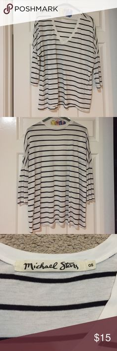 Michael stars back and white striped light tee 3 quarter sleeve, Baggie. smoke free home. One small hole on left shoulder.(I think from the tag) worn once. Michael Stars Tops Tees - Short Sleeve