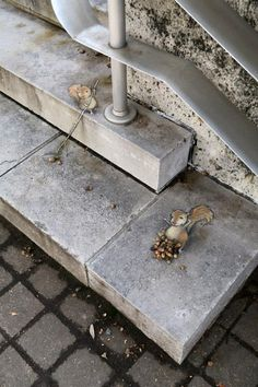"""""""'The Fall Collection', chalk, charcoal and found objects on municipal bedrock."""""""