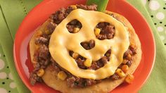 Even excited trick-or-treaters will take time to enjoy a smiling jack-o'-lantern pizza made with easy Grands!® biscuits.
