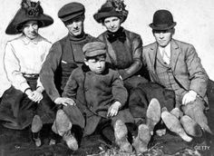 A six-year-old John Dillinger poses for a photo with his family.   Read the Story of John Dillinger, Public Enemy No. 1