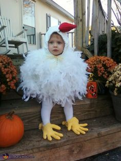 """I made this costume for my grandson Mikee. I used a zip up hoodie with a white t-shirt sewn inside with batting stuffed in between the two for fullness. White boas were sewn on the hoodie and the red on top was made with felt.""  Cute. I believe the feet are rubber gloves."