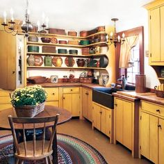Love the apron front sink, all the open shelves & different base cabinet depths. Perfect provincial home look!