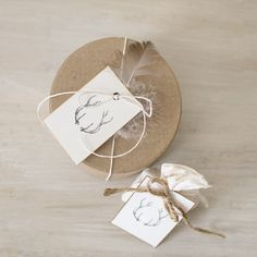 Beautiful packaging using our antler stamp, parcel twine (tm) and round favor boxes. Photo + styling by the talented Meg Fish!    www.megfish.com