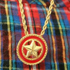 FINAL PRICE  Monet Red Enamel Star Necklace Such a beautiful  Vintage designer signed Monet necklace.  Bright red enamel surrounding rich 24k Gold plate. Rope details match perfectly with the approximately 20 inch long rope chain. Its also signed monet. Monet Jewelry Necklaces