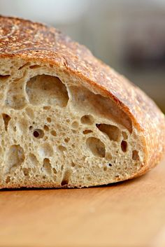 How to make artisan sourdough bread at home including information on maintaining a healthy starter. You'll never buy bread again!