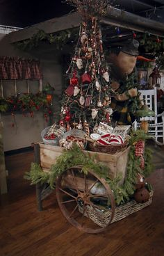 Old Wagon...stuffed with a prim tree & pine...The Olde Homestead: