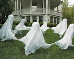 DIY Halloween floating ghost ring. Make a ring-around-the-rosie scene of lawn ghosts! All you need to do is poke a Styrofoam ball through the top of a fence stake or dowel, stick it in the ground and cover with white fabric or cheesecloth. I love this because it has great visual impact, but it's easy to store away after the season!