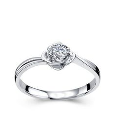 Enchant your sweetheart and give her the surprise of the lifetime from the line this Enthralling Solitaire Wedding Ring, which is beautiful and affordable. The Ring can be made in 10k, 14k or 18k White Gold, Yellow Gold or Rose Gold. This ring can be customized to Round cut or Princess Cut center diamond. The ring comes with its own Free Elegant Jewelry Box.