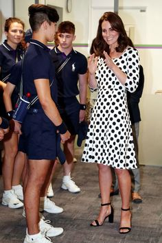 Kate Middleton Photos Photos - Catherine, Duchess of Cambridge meets ball boys and girls on day one of the Wimbledon Championships at The All England Lawn Tennis and Croquet Club, in Wimbledon on July 3, 2017 in London, England. - The Duchess of Cambridge Visits the All England Lawn Tennis and Croquet Club