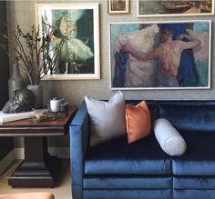 Blue couch / art / wallpaper