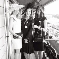 A picture of Zenouska Mowatt, (center) daughter of Marina Ogilvy Mowatt and Paul Mowatt and granddaughter of Princess Alexandra of Kent, with friends in June 2013, wearing a Jane Taylor hat.