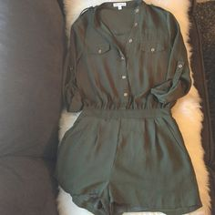 Olive green romper Great romper. Only worn once and no signs of wear. Comes with belt. Purchased at a local boutique. Dresses
