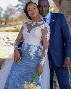 Top lace shweshwe dresses for a walk with their companions African Print Wedding Dress, African Wedding Attire, African Attire, South African Traditional Dresses, Setswana Traditional Dresses, Traditional Wedding Attire, Shweshwe Dresses, African Wear Dresses, African Print Fashion