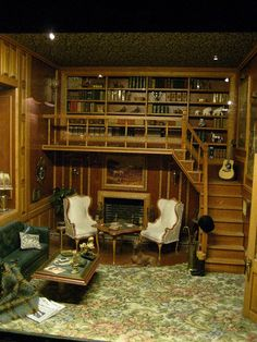 This image is actually a miniature, but I would love a library with a book loft like this one...