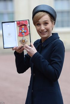 What a Dame! Kristin Scott Thomas has collected her damehood from the Queen at Buckingham Palace