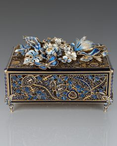 """Handcrafted chest. Made of pewter. 14-kt. gold, medium brown, and brass ox finish. Hand enameled and hand set with Swarovski crystals. 14.25""""W x 10.5""""D x 9.5""""T. Made in the USA."""
