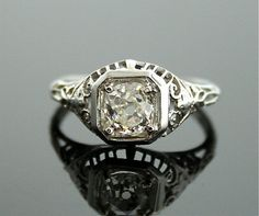 Antique diamond ring by SITFineJewelry on Etsy for $2490.00.  I just love these vintage white gold rings.