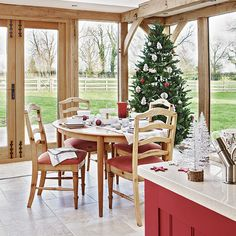 Kitchens: Rustic Kitchen with Round Dining Table also Wooden Dining Chairs plus Red Kitchen Island and White Countertop
