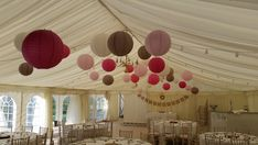 Latte and Pink Lanterns Decorate a Rustic Marquee