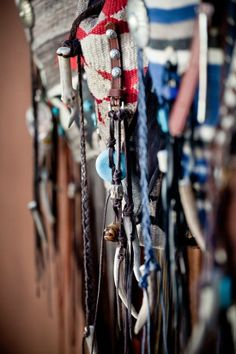 Across the body bags: Navajo Handbags made from blankets / rugs, vintage horse tack, and deer, elk or cowhide leathers. I embellish the bags with vintage trade beads, turquoise, coral, nickel silver/German silver Concho buttons, nickel silver spots/studs, and deer antler tips