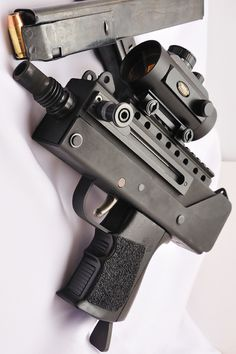 MAC 10 SMG, The MAC-10 (Military Armament Corporation Model 10, officially the M-10) is a highly compact, blowback operated machine pistol developed by Gordon B. Ingram in 1964.In 9mm or .45 ACP caliber.