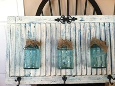 Repurposed shutter I made with old Mason jars with burlap wrap and some hooks.painted three colors for a unique fun distressed look.