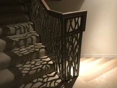 Laser cut screens - Balustrade finished in bronze - design by Miles and Lincoln. www.milesandlincoln.com