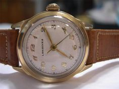 VINTAGE 1940'S LONGINES DRESS WATCH IN 14KT CASE AND CALFSKIN STRAP! On Ebay right now!