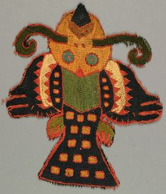 """Winged bird or fish-like monster embroidered in strong colors.    This fragment is technique: stem stitch on plain weave.    This fragment is from Peru and dated """"300–100 BC""""."""