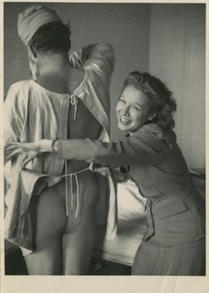 """1944, 'Hemingway in Hospital After a Party', London    """"My favorite fun photo by Bob Capa: his girlfriend 'Pinky' and Ernest Hemingway, who was in a London hospital as a result of an all-night party given for him by Capa. I had offered 'Papa,' as Capa called him, a safe ride home to the Dorchester, but he took another offer, from a driver who plowed into a water-storage tank, and Papa went through the windshield."""""""