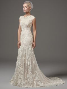 modest wedding dress in sheath shape for lds wedding. lace wedding dress with cap sleeves, perfect for temple wedding.