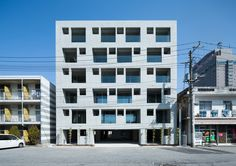 Built by Soeda and associates Architects in Chiba, Japan with date Images by Takumi Ota. The site is located at 300 meters from Tokyo Bay. This apartment building stands on a wholesale block marked by the u. Commercial Architecture, Facade Architecture, Beautiful Architecture, Contemporary Architecture, Terrace Design, Facade Design, Building Skin, Composition Design, Interesting Buildings