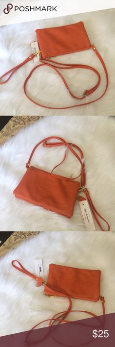 🌺🌺 Crossbody Bag and Wristlet NWT Orange detachable strap crossbody bag that doubles as a wristlet. This soft faux leather bag has 5 compartments including an area for 6 credit cards! Super compact yet very roomy. ASKING PRICE OR BEST OFFER! Bags Crossbody Bags