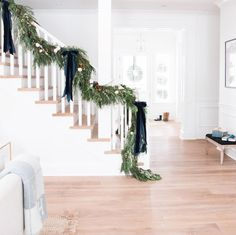 i put some garland on our staircase this weekend and i'm kind of obsessed with it! so i thought i'd round up more staircase garland to oggle.