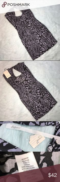 NWT Reformed By The Reformation Animal Print Dress NWT Reformed By The Reformation from Urban Outfitters Gray & Black Animal Print Dress with button down back of dress. Size medium. Made of 60% rayon & 40% nylon. New with tags and never worn. Measurements: underarm to underarm is 18 inches. Length is 36 inches. Urban Outfitters Dresses Midi
