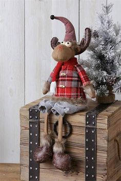 Plaid Sitting Moose Doll - This cozy sitting moose doll wears a gray, black, and red plaid swear lined with faux fur, and a patterned stocking hat topped with a rusty bell. Christmas Moose, Diy Christmas Ornaments, Winter Christmas, Christmas Decorations, Holiday Decor, Chocolate Moose, Moose Decor, Reindeer, Merry