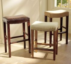 Pottery Barn. Fabulous leather bar stools with a saddled seat