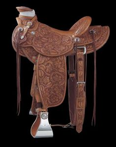 Dale Harwood 2005 Gear ~ TCAA - 'Weekend Saddle' on a 1940-pattern Wade tree. It has a copper roseflower stamp, 15-inch seat, Cheyenne roll, 2 ¾ inch high cantle, three-quarter double rigging, round skirts and five-inch stainless steel covered stirrups with block.