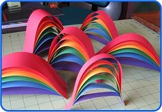 "rainbows for my class to make   RECIPE: 6 - 2"" strips of paper:  2""x12"" in red  2""x11"" in orange  2""x10"" in yellow  2""x 9"" in green  2""x 8"" in blue  2""x7"" in violet"