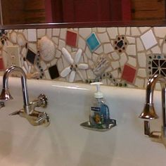 """This is a backsplash I created from  found"""" things and tiles and glass"""